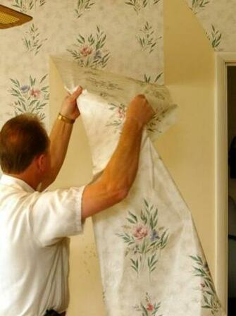 wallpaper contractor demonstrates the proper way to remove wallpaper