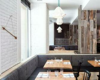 makes peel and stick wood wallpaper from reclaimed weathered planking