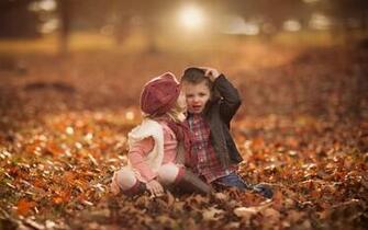 Cute Girl Kiss Boy Fall Leaves 1280 x 800 Download Close
