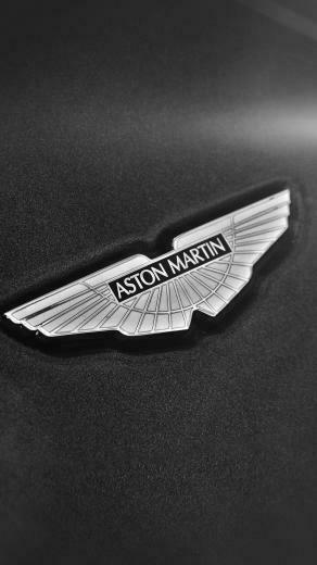 Simple Aston Martin Logo Dark Background iPhone 8 Wallpaper
