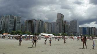 People enjoying a summer day at Santos beach Santos Sao Paulo