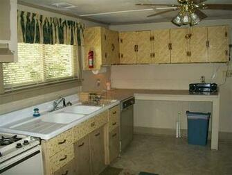 wallpaper placed over kitchen cabinet drawer doors fixer upper Macon