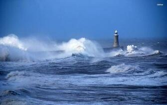 Rough waves hitting the lighthouse wallpaper   1068483
