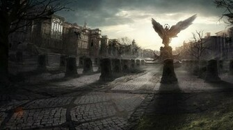 Angel statue in a destroyed city wallpapers and images   wallpapers