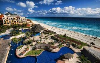 Tropical Beach Ocean Hotel ocean waves sky clouds wallpaper background