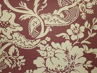 damask style wallpaper printed in beige on a burgundy background