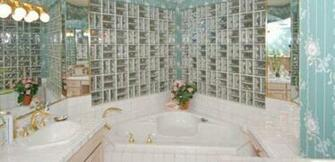 1980s BathroomGlass block walls gold fixtures floral wallpaper lots