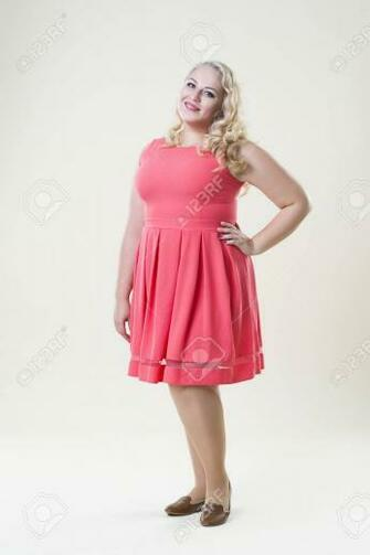 Plus Size Fashion Model Fat Woman On Beige Background Overweight