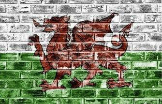 Welsh Flag Applied To A Rough Textured Brick Wall To Be Used