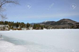 Mirror Lake In Winter With Whiteface Mountain At The Background