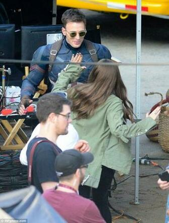 Elizabeth Olsen and Chris Evans on the set of Captain America
