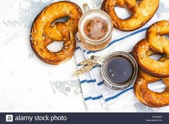 Beer and pretzels on white background Oktoberfest party Stock