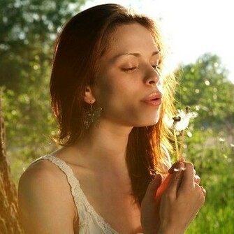 Download Girl Blowing Dandelion Wallpaper For iPad