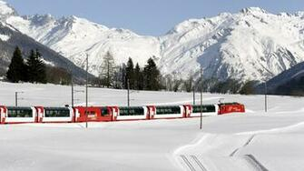 Passenger train in the snow in Switzerland wallpapers and images