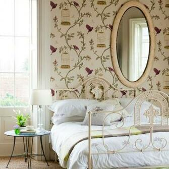 Hang stunning gilded bird cage wallpaper in a bedroom for a pretty
