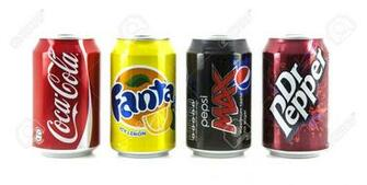 SWINDON UK   MARCH 2 2014 Four Popular Drink Cans On A White