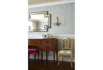 The gold leaf wallpaper adds a touch of royalty to this dining room