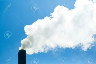 White Smoke Comes From The Chimney On The Background Of Blue