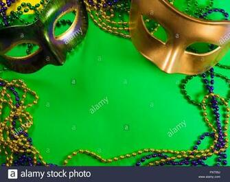 Mardi Gras mask with beads on a green background Stock Photo