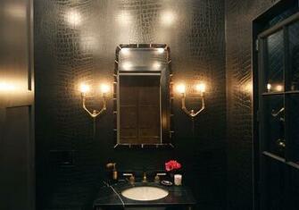 bathroom faux croc wallpaper black marble top washstand black doorjpg