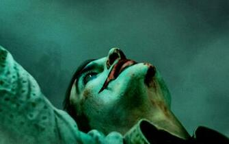 Wallpaper of Joaquin Phoenix Joker Joker 2019 Poster background