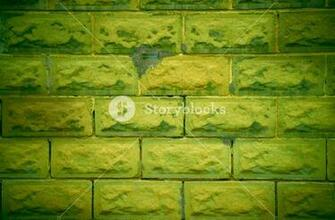 Weathered and rough old lime green wall background Royalty