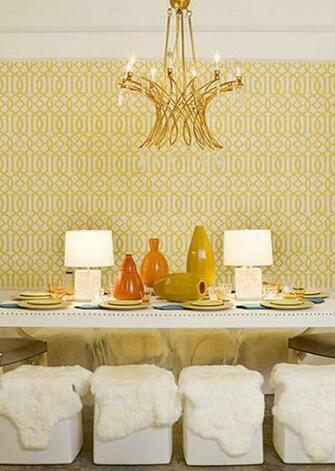 room design with brass chandelier yellow imperial trellis wallpaper
